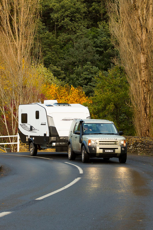 car-towing-caravan-on-a-bend-of-the-road